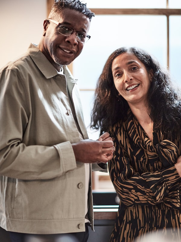 Portrait of a smiling man and woman.