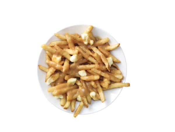 Poutine on a white plate and white background.