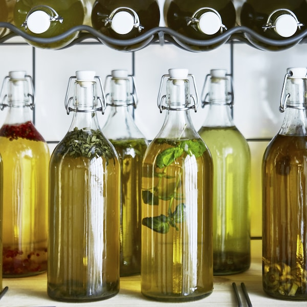 Racks of glass KORKEN bottles filled with cooking oil