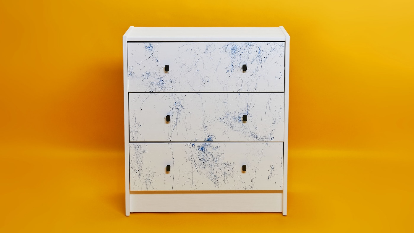 RAST chest of drawers painted with marble pattern.