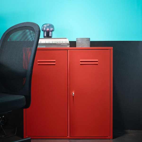 Red metal storage cabinet with office chair beside