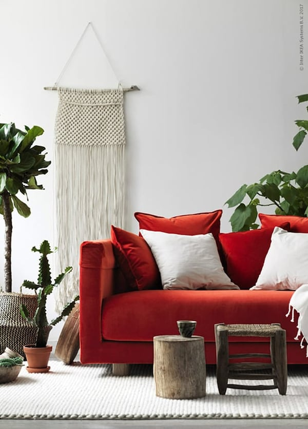 Red sofa in a light and natural interior