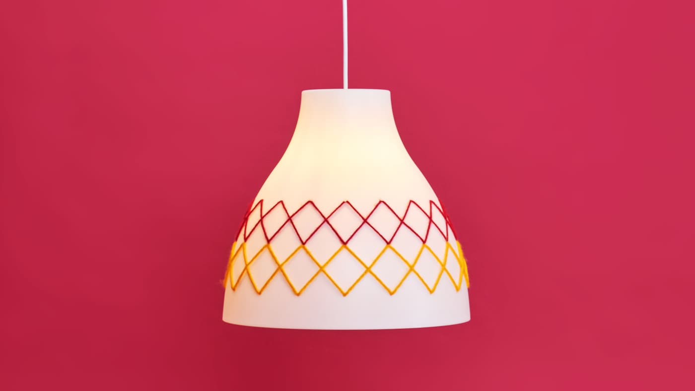 Redesigned melody lamp on a pink background.