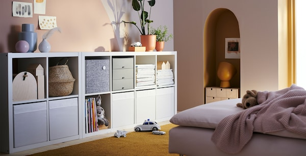 Room with KALLAX storage system against a wall