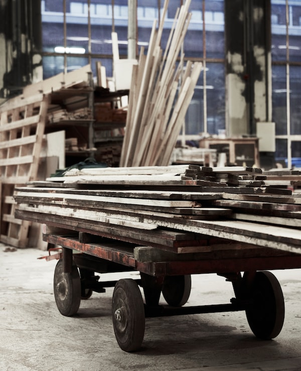 Rough cuts of wood stacked up in a workshop.