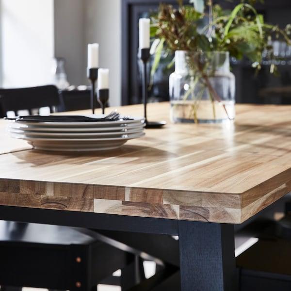 Sådan vælger du materiale til dit spisebord.