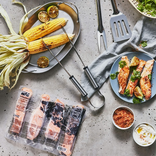 Salmon, corn and other foods on a table