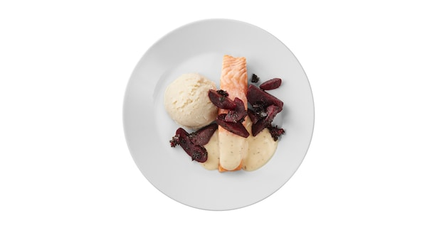 Salmon fillet with lemon dill sauce, beetroot and kale mix.