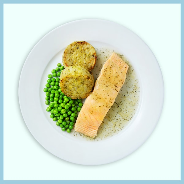 Salmon fillet with vegetables medallion and green peas