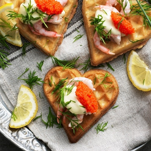 Savory waffles with shrimps and seaweed pearls.