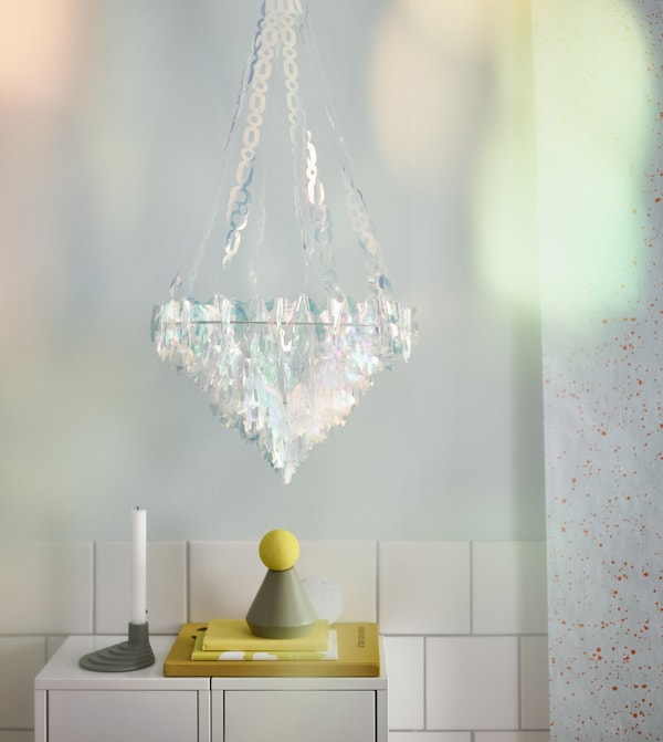 Scandinavian home decor from IKEA comes in all shapes and sizes. This VINTER 2017 hanging decoration has plastic, iridescent pieces that look like a chandelier. It makes an unexpected statement that turns every day into a celebration.