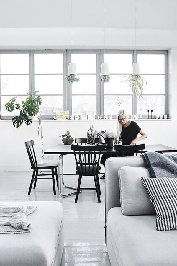 Scandinavian interior; woman at dining table