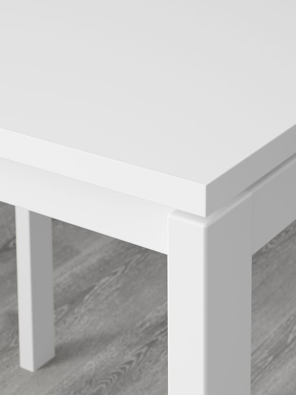 Section of a white MELLTORP table top made in durable melamine.