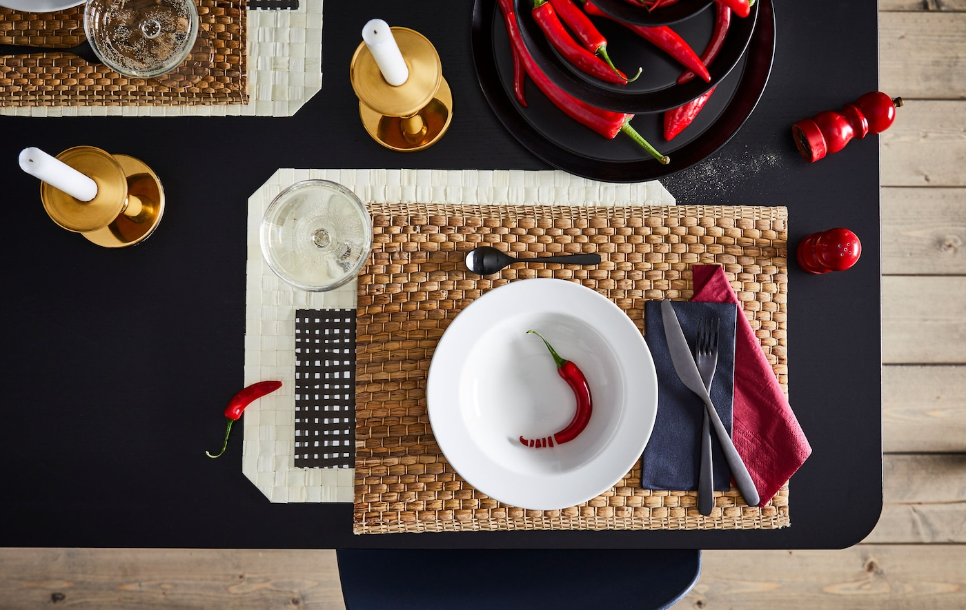 Section of dining table with an artful setting for one, including coordinated colours, shapes and materials.