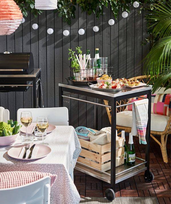 Serve food on a smart trolley that's easy to move around, such as IKEA KLASEN trolley in stainless steel.