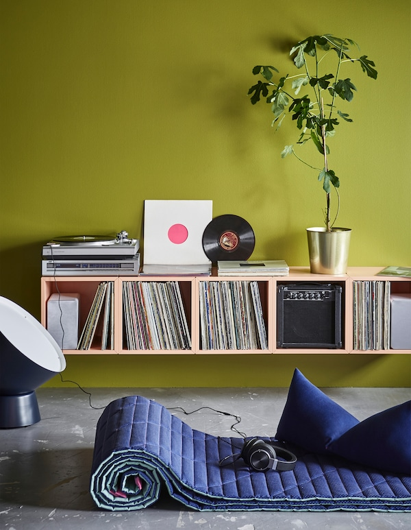Set up a home DJ-station using modern furniture from IKEA! Create an asymmetric or unexpected storage solution with a couple of EKET cabinets in light orange and fill them with your things. Stack and combine as you please. Fits in any space.