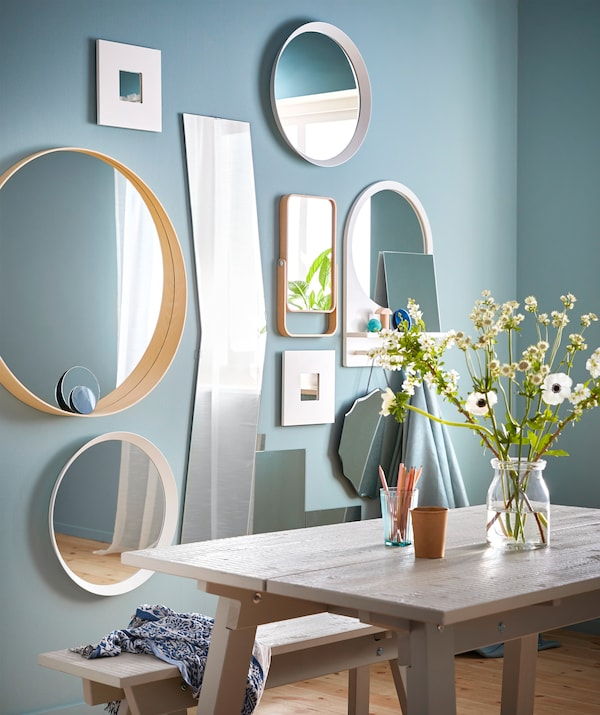 Set up a stylish collage wall of mirrors! Try a mix of different styles such as IKEA SALTRÖD mirror with shelf and hooks.