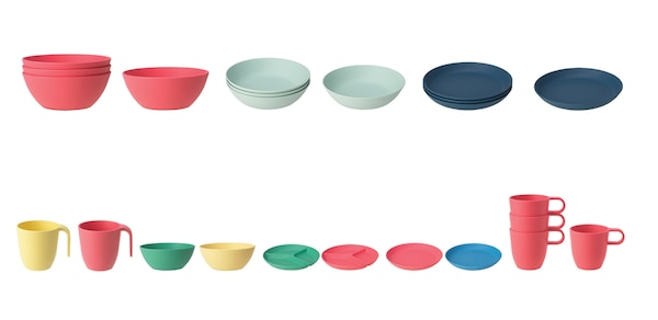 Several colorful bowls, plates, and cups lined up in a row against a white background.