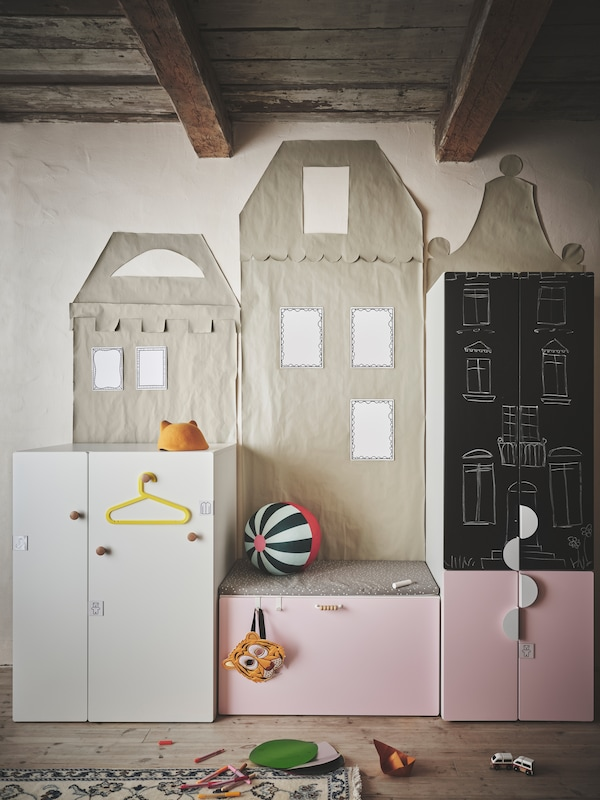Several units of SMÅSTAD storage series with different coloured fronts and handles of various styles placed in a kid's room.