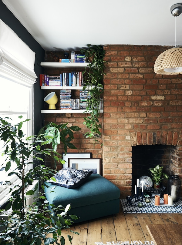 Shelves in an alcove and a green footstool.
