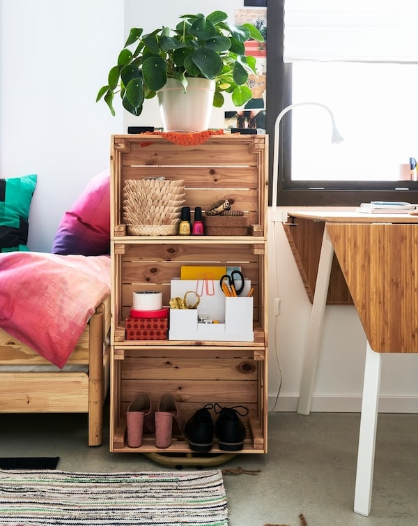 Shelving unit with re-used boxes