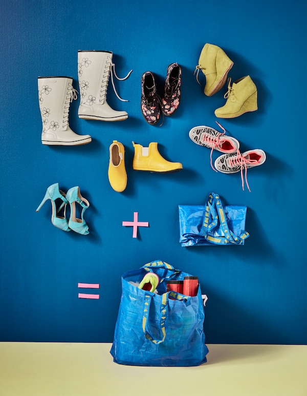 Shoes being packed into an IKEA blue bag