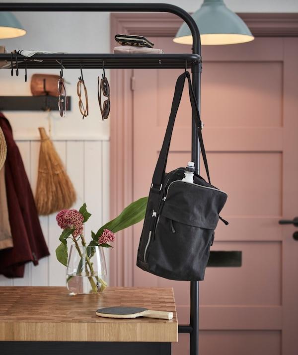 Shoulder bag hanging from the VADHOLMA kitchen island rack.