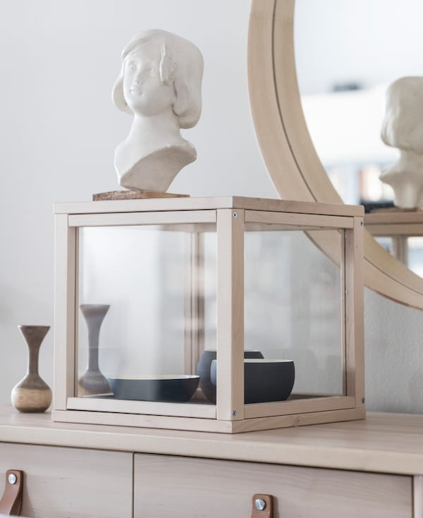 Show off your favorite accessories in a display case like IKEA SAMMANHANG. Its clean lines really compliment round and organic shapes.