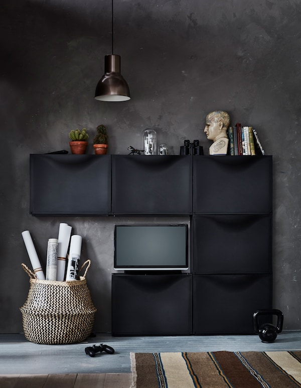 Six IKEA TRONES shoe cabinets are arranged to create an entertainment center, with a TV sitting on one.