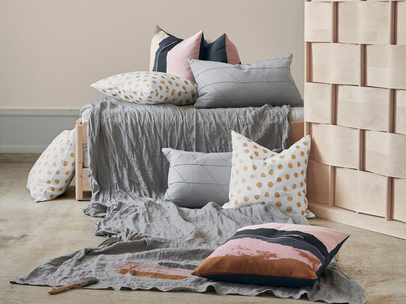 SKÄGGÖRT cushion cover with fun golden dots, and the ELDTÖREL cushion cover, plenty of mix cushions on the floor.