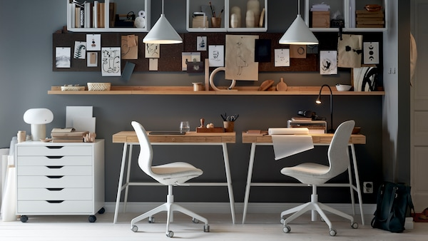 Small and smart workspace, double desks used in hallway, with cube storage and message boards hung above
