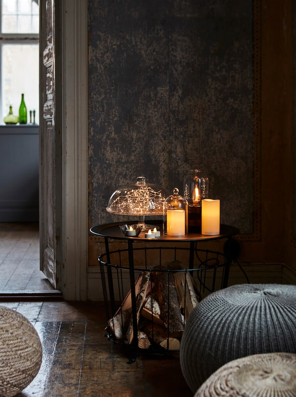 Small table adorned with candles and decorative lighting