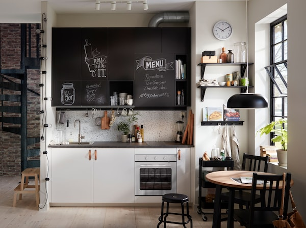 Small white kitchen with kitchen doors on which you can chalk texts