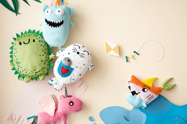 Soft toys with funny faces and features drawn by kids and produced by IKEA and sold in IKEA stores globally.