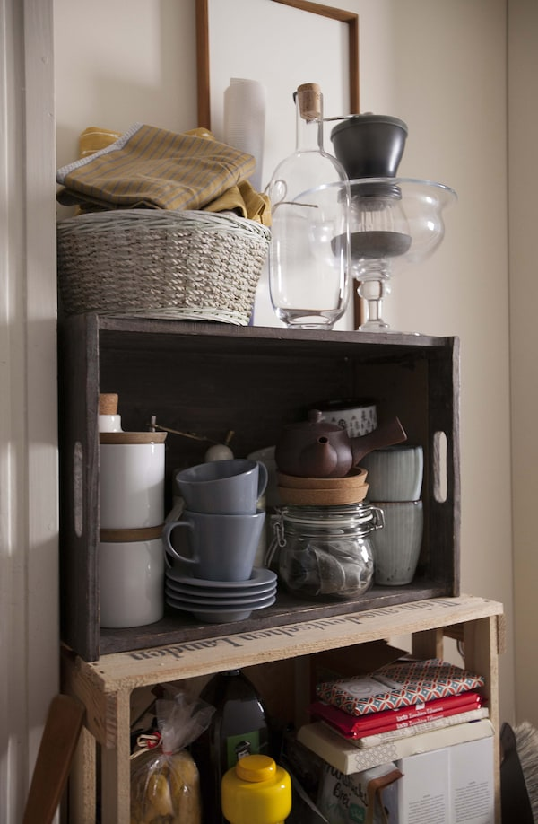 Some plant pot and other items, stored on shelves.