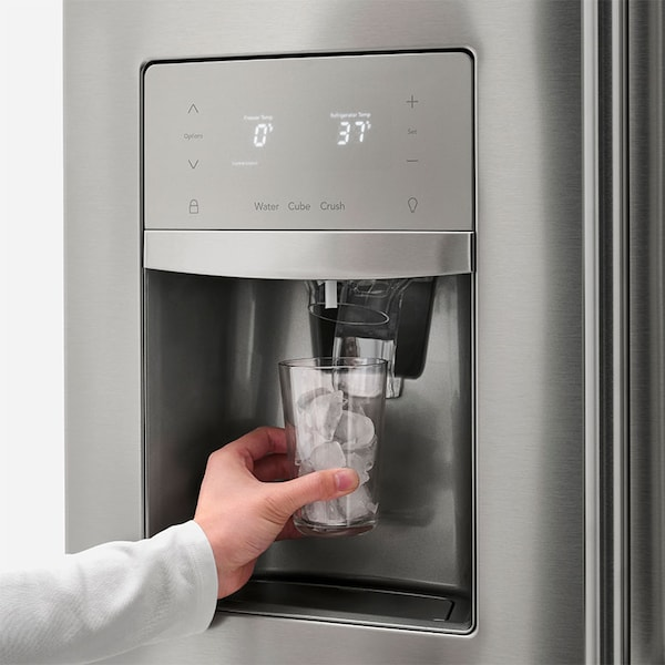 someone filling up a glass from the fridge water dispenser