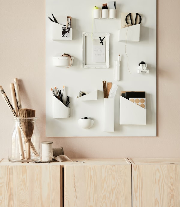 Sometimes the simplest things are the most beautiful – and smart! Use a couple of IVAR cabinets in untreated wood to store things you want to hide away.