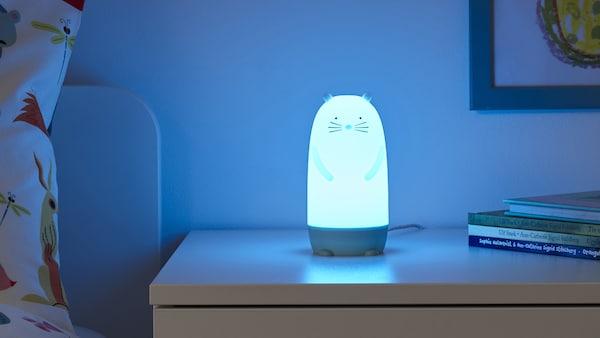 SPIKEN nightlight glowing blue in a child's room