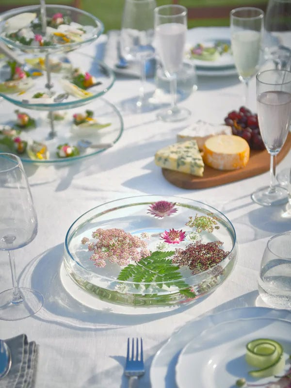 Spring table with glasses and collection of foods outside