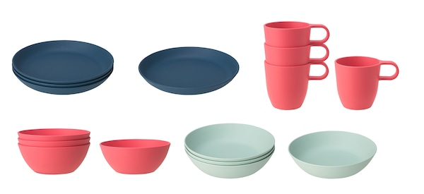 Stacks of dark blue plates, pink bowls and mugs, and light green bowls from the TALRIKA series against a white background.