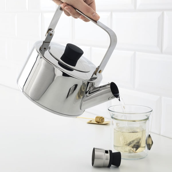 Stainless steel kettle pouring tea