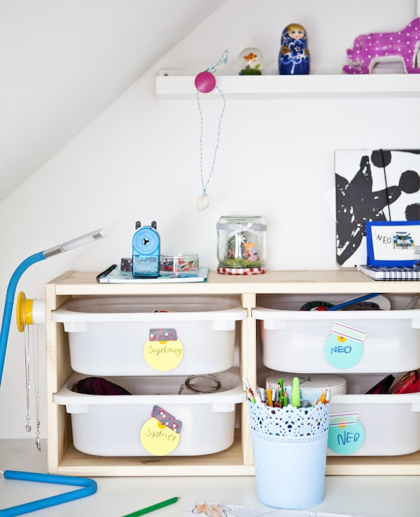 Storage boxes with colourful labels.