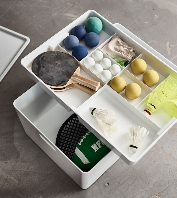 Storage boxes with interior organisers are a perfect way to keep smaller items neat.