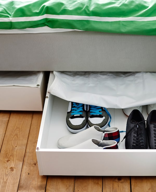 Storage under the bed hides shoes away