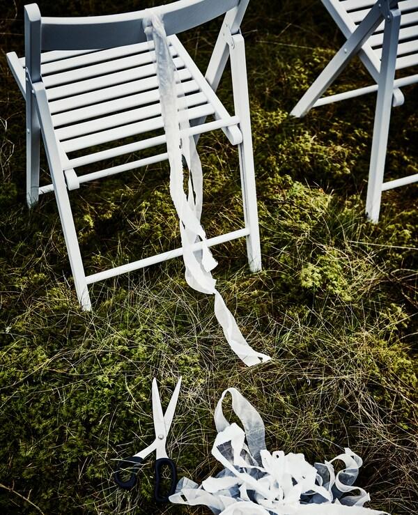 Streifen von SOLIG Netz an TERJE Klappstuhl in Weiß
