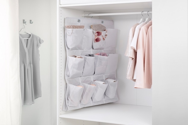 STUK hanging shoe organizer with 16 pockets, hanging in a closet