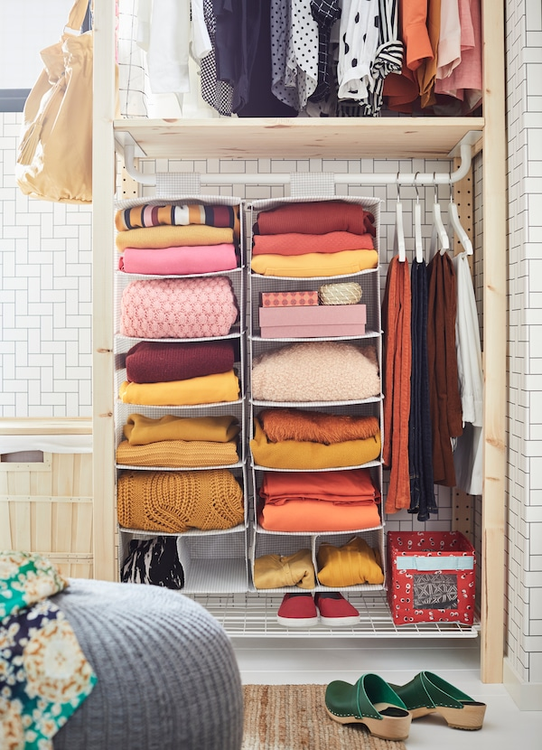 STUK white hanging storage organiser with 7 square compartments for folded sweaters and accessories.