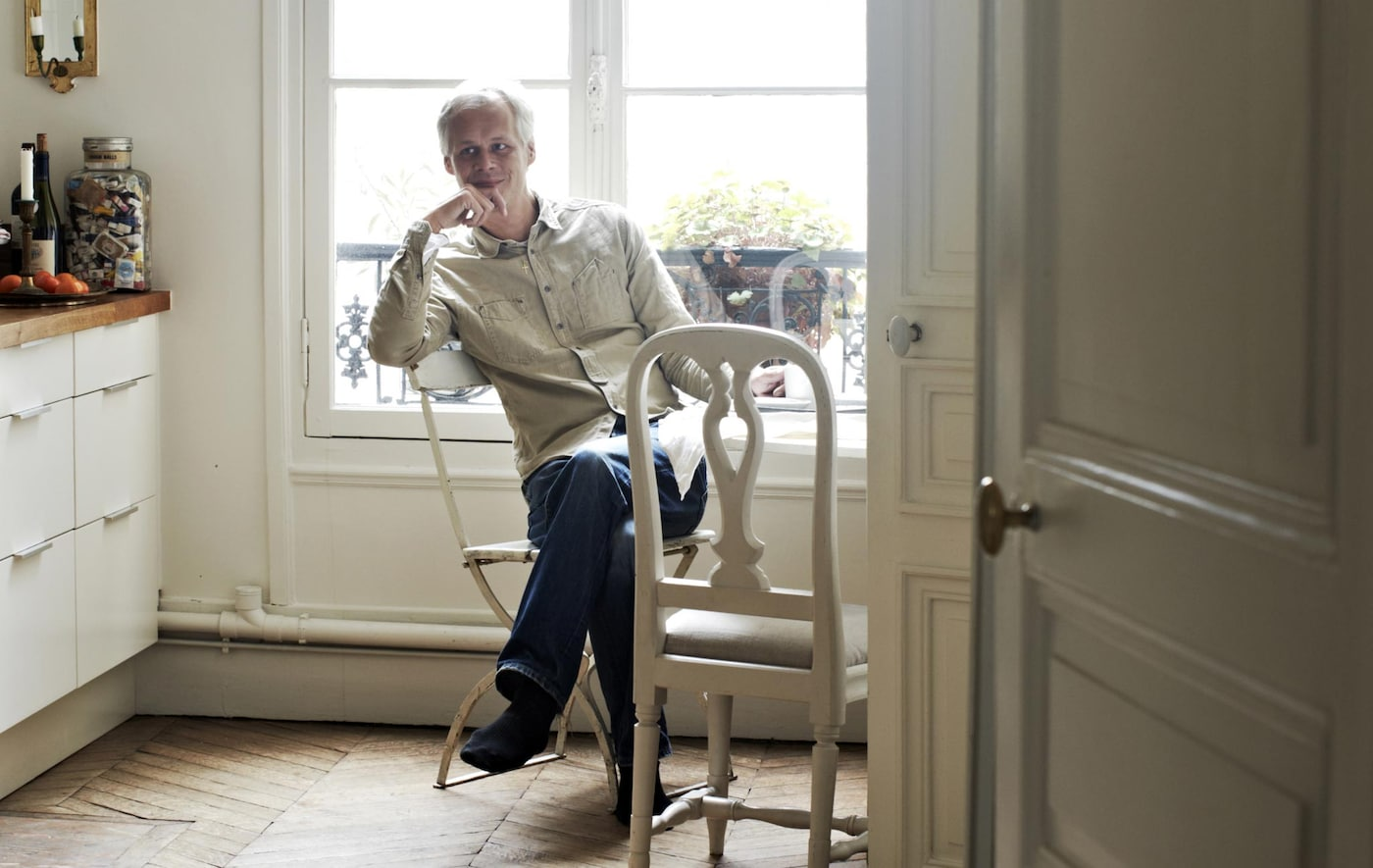 Stylist Hans Blomquist relaxes at his kitchen table.