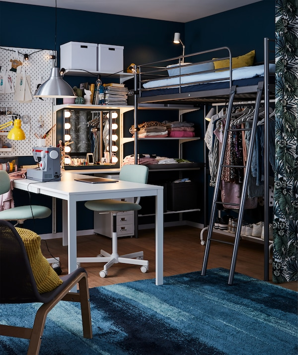 SVÄRTA loft bed frame in silver-coloured steel with a ladder frees up floor space.