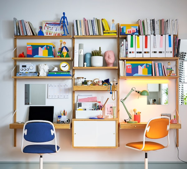 SVALNÄS wall-mounted workspace combination in white/bamboo, with lots of books, folders and other objects on the shelves.